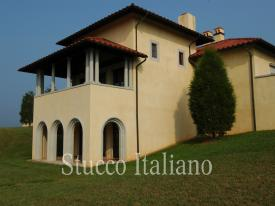 luxury county house plastered with ventian dilavato stucco